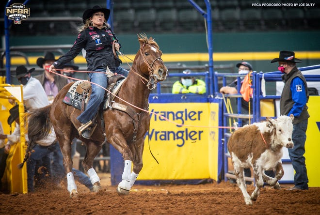 Stephenville's Jackie Crawford participates in the inaugural breakaway roping event on Tuesday at the Wrangler National Finals Rodeo in Arlington. Crawford won round one with a time of 1.9 seconds.