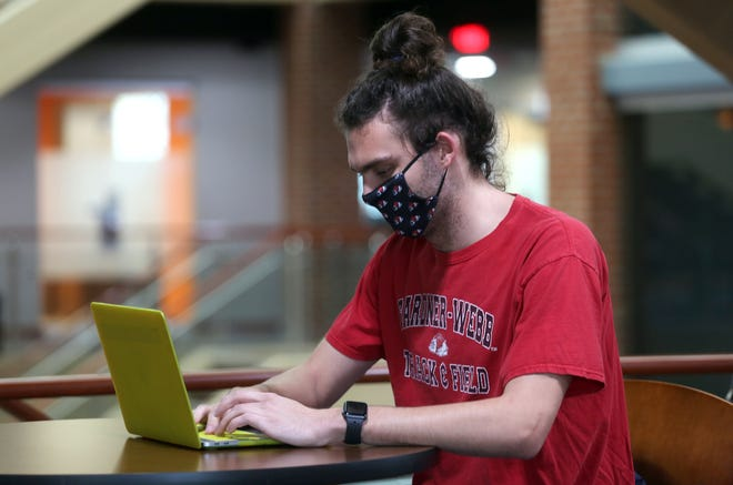 Austin Buzzard works with remote learning classes at Gardner-Webb University on Monday. Buzzard is one of many students who chose to stay on campus.