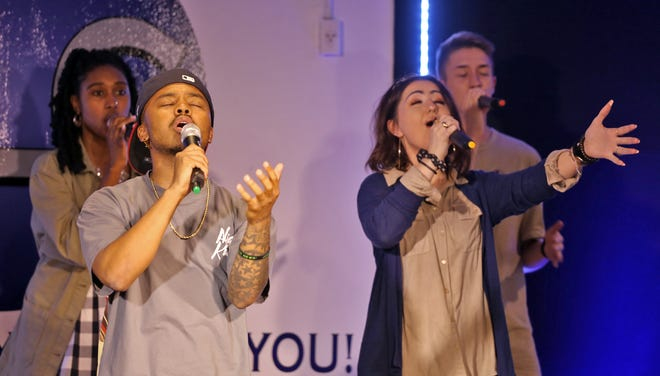 Jarius Strong and Kendall Cudd sing worship songs at Destiny Life Center in Shelby.