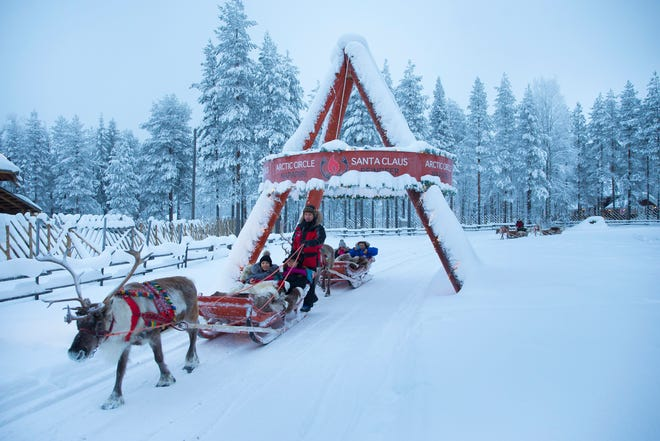 """Leroy Anderson's popular """"Sleigh Ride,"""" conjures up images of traditional winter scenes, like this reindeer sleigh ride in Ravaniemi, Finland, near the Arctic Circle, which claims to be the """"Official Hometown of Santa Claus."""""""
