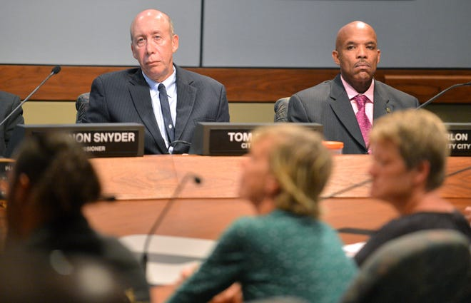 Sarasota City Manager Tom Barwin, left, was forced out by the City Commission. Deputy City Manager Marlon Brown, right, will replace Barwin.