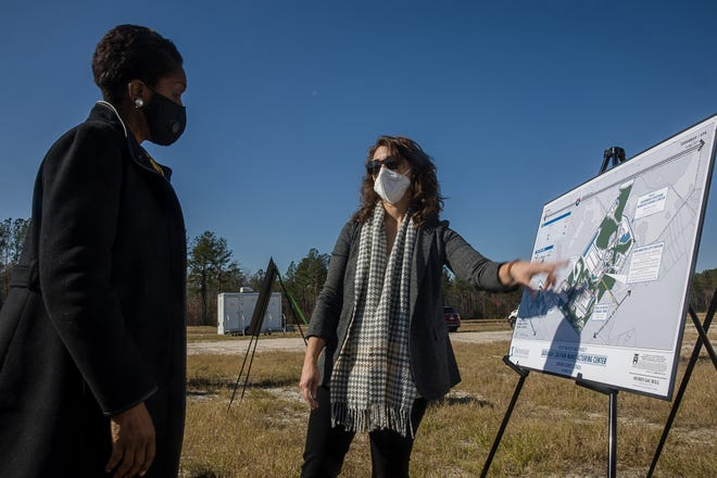 Jesse Dillon, Vice President of Business Devlopment Savannah Economic Development Authority, points to the site map as she talks with Aubrey King Tuesday during a ribbon cutting for the Savannah Chatham Manufacturing Center off Old River Road. [Richard Burkhart for Savannah Morning News]