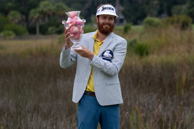 Evan Harmeling receives his jacket and trophy after winning the Korn Ferry Tour's third annual Savannah Golf Championship in October at The Landings Club's Deer Creek Course.