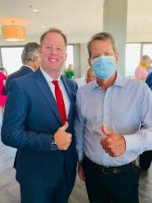 Chatham County Police Department Capt. Gene Harley with Georgia Gov. Brian Kemp. [Photo courtesy of Facebook]