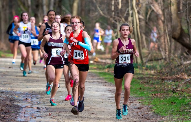 Smyrna's Alyssa Young (in red jersey) races in the Division 1 cross country championship at Killens Pond State Park Dec. 5. She placed ninth and earned Second Team All-State honors for Division I.