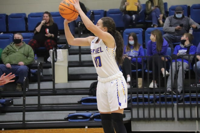 Bethel's Parker Stevenson fires off a shot against visiting Harrah Monday night. Stevenson poured in 40 points and hustled for 10 rebounds as the Lady Wildcats beat Harrah, 65-54.