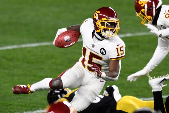 Washington Football Team wide receiver Steven Sims (15) returns a punt during the first half of an NFL football game against the Pittsburgh Steelers in Pittsburgh, Monday, Dec. 7, 2020.