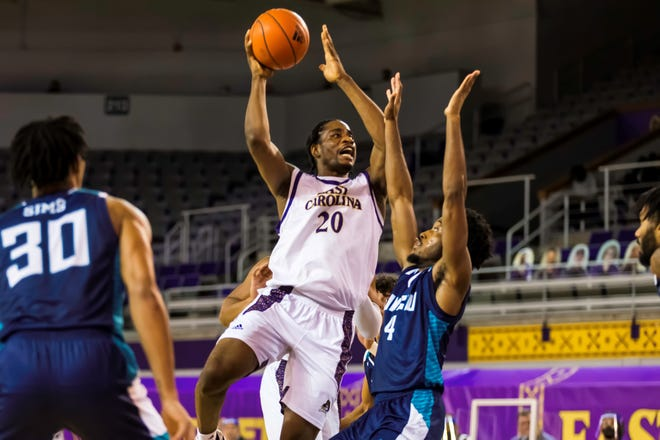 ECU's Bitumba Baruti defended by UNCW's Mike Okauru on Monday night. The Pirates outlasted the Seahawks in overtime, 88-78. (Courtesy of ECU Media Relations)