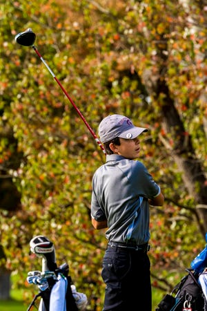 Bishop Stang's Kyle Farias tracks his drive on Hole 4 at the Country Club of New Bedford.  [RYAN FEENEY/STANDARD-TIMES SPECIAL/SCMG]