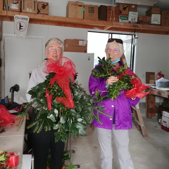 Members of the Trent Woods Garden Club prepare to start decorating. [CONTRIBUTED PHOTO]