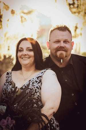 """Ashley """"Ryan"""" Burroughs and wife Alison Burroughs"""