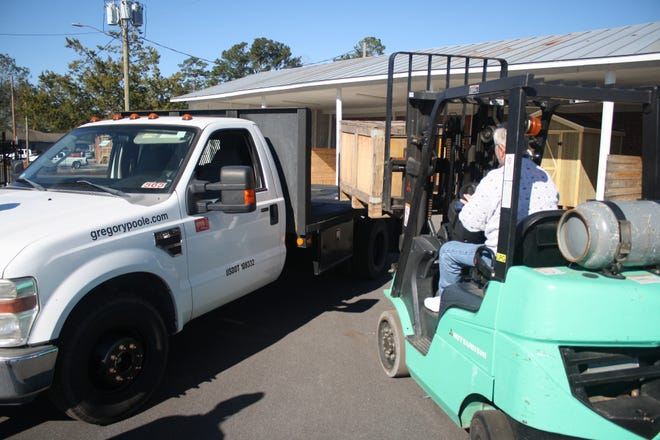 Eddie Foster, executive director of the Volt Center, uses a forklift to unload equipment that Gregory Poole donated to the college's new Diesel Technology program. The program, which also received equipment donations from Volvo and Caterpillar, will begin Jan. 11. [CONTRIBUTED PHOTO]