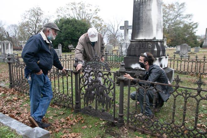 George Blake, Jim Hodges and Jon Burger discuss rehanging the Benjamin Ellis gate. [Bill Hand / Sun Journal Staff]
