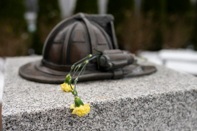 A single flower on the memorial honoring Worcester Firefighter Jon Davies Sr., killed on Dec. 8, 2011, while fighting a fire on Arlington Street.