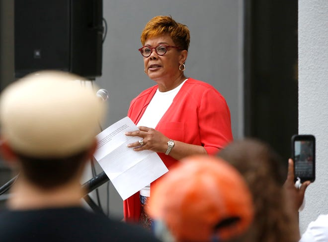 Cynthia Chestnut, chairwoman of the Alachua County Democratic Party, speaks during a candlelight vigil for victims of violence in Virginia, at Gainesville's City Hall in August 2017. Chestnut is running to become the state's Democratic Party leader.