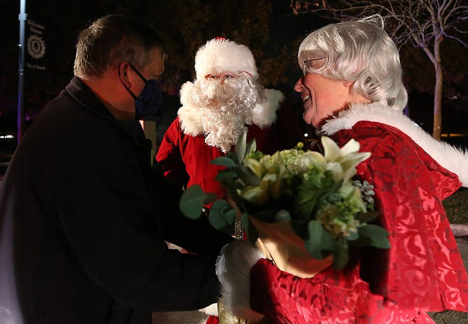 Liberty Township firefighter Sean Worley talks with Santa and Mrs. Claus after they step off the fire truck at the Village Green in Powell to help the mayor (Frank Bertone) light the Christmas tree Dec. 5. Lewis Center residents might recognize Rick and Susie Ross.