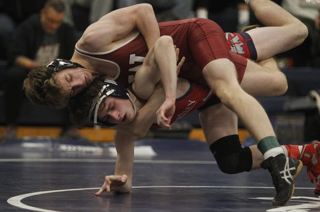 """Junior Leo Pavell (top) is back at 138 pounds for Watterson after going 34-24 last season. In their third season back after a two-year hiatus, coach Felix Catheline said it's time for the Eagles """"to slay the dragon as a team and push our program to the next step."""""""