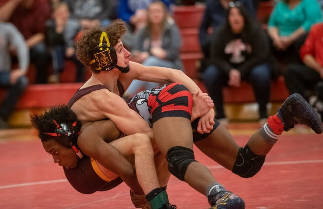 North's Jake Gooding (top) competes against South's Fuanyi Fobellah last season. Both are among the top returnees for their teams after qualifying for the Division I state tournament last winter.