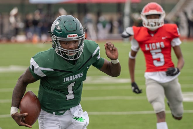 Waxahachie senior quarterback Brandon Hawkins Jr. (1) scrambles for yardage against Waco High two weeks ago at Lumpkins Stadium. The Indians will travel to Temple on Friday for the bi-district round of the Class 6A Division II playoffs.