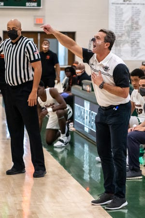 Waxahachie head boys' coach Greg Gober shouts instructions during Friday night's home game against Richardson High at Mike Turner Gymnasium. The Class 6A No. 4-ranked Runnin' Indians won, 71-68.