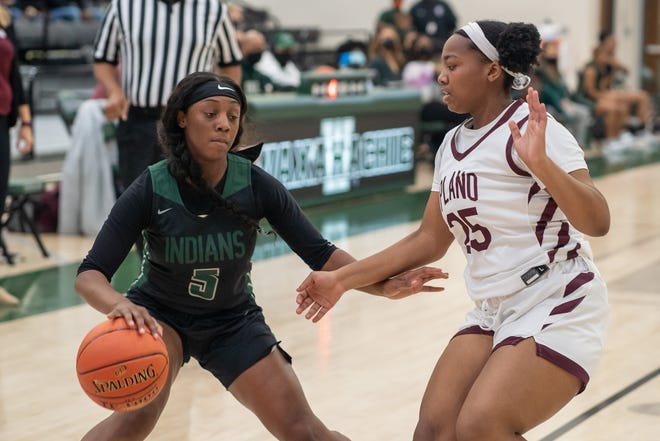 Waxahachie's Cha'darian Miles works the ball against Plano during a recent game at Mike Turner Gymnasium.
