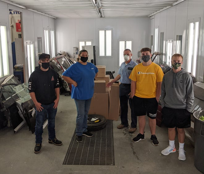 Nicole Butcher (second from left), a sales representative from LKQ Corporation, recently visited the CTE Center at Ellicottville to deliver a donation of parts to the Collision Repair and Auto Body Technology programs. Instructor, Ed Arnold (third from right) accepted the donation along with students from the program.