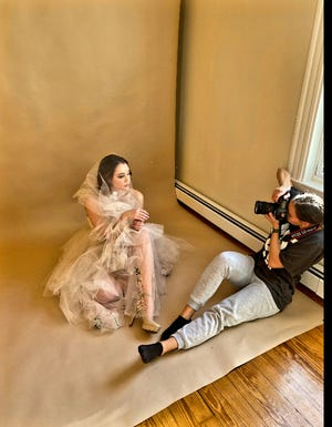 Brookline photographer Lena Nugent in a photoshoot with one of her subjects.