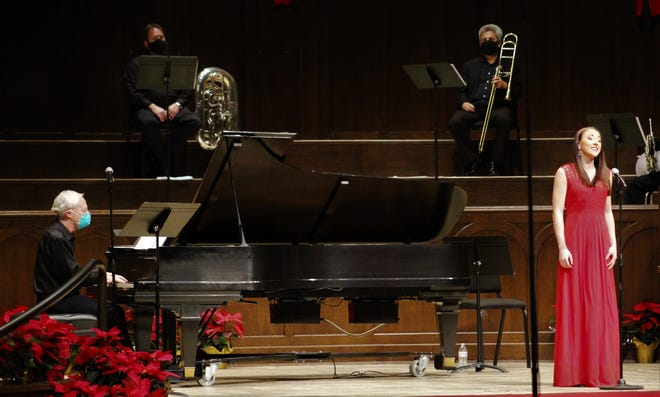 Social distance was in effect at Saturday's Abilene Philharmonic holiday concert at First Baptist Church. Brass players sat in what normally is the choir area in the sanctuary, with pianist David Itkin and vocalist Sara Kennedy distant. All wore masks, except for Kennedy when she was singing.