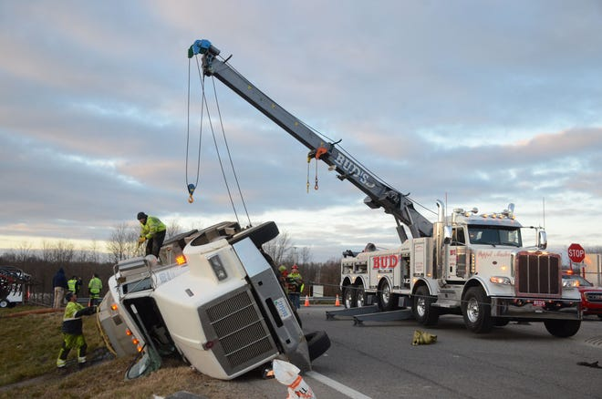 Wrecker crews work to clear the damaged tanker Monday