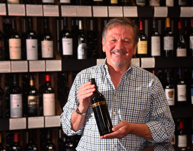 Tim Dwight, proprietor of the Green Turtle Market with his top wine pick of the year- Typsetter Napa Cabernet Sauvignon 2018