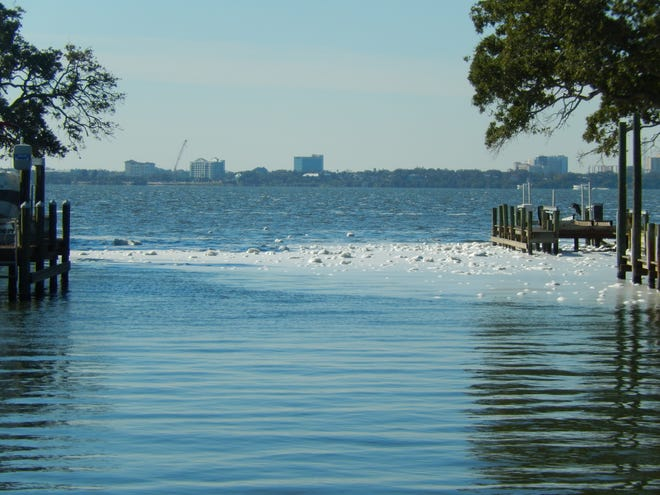 The Indian River Lagoon began to foam up this week near Indialantic, as winds lathered up thick algae.