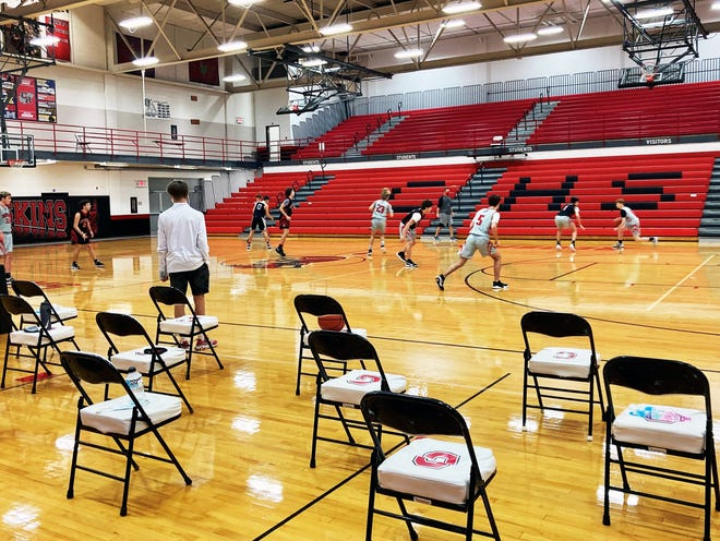 Chairs are spread along the sideline as Coshocton's boys basketball team practices last week at The Wigwam. Distancing chairs is among many safety measures being institituted by the Ohio High School Athletic Association to combat spread of COVID-19.