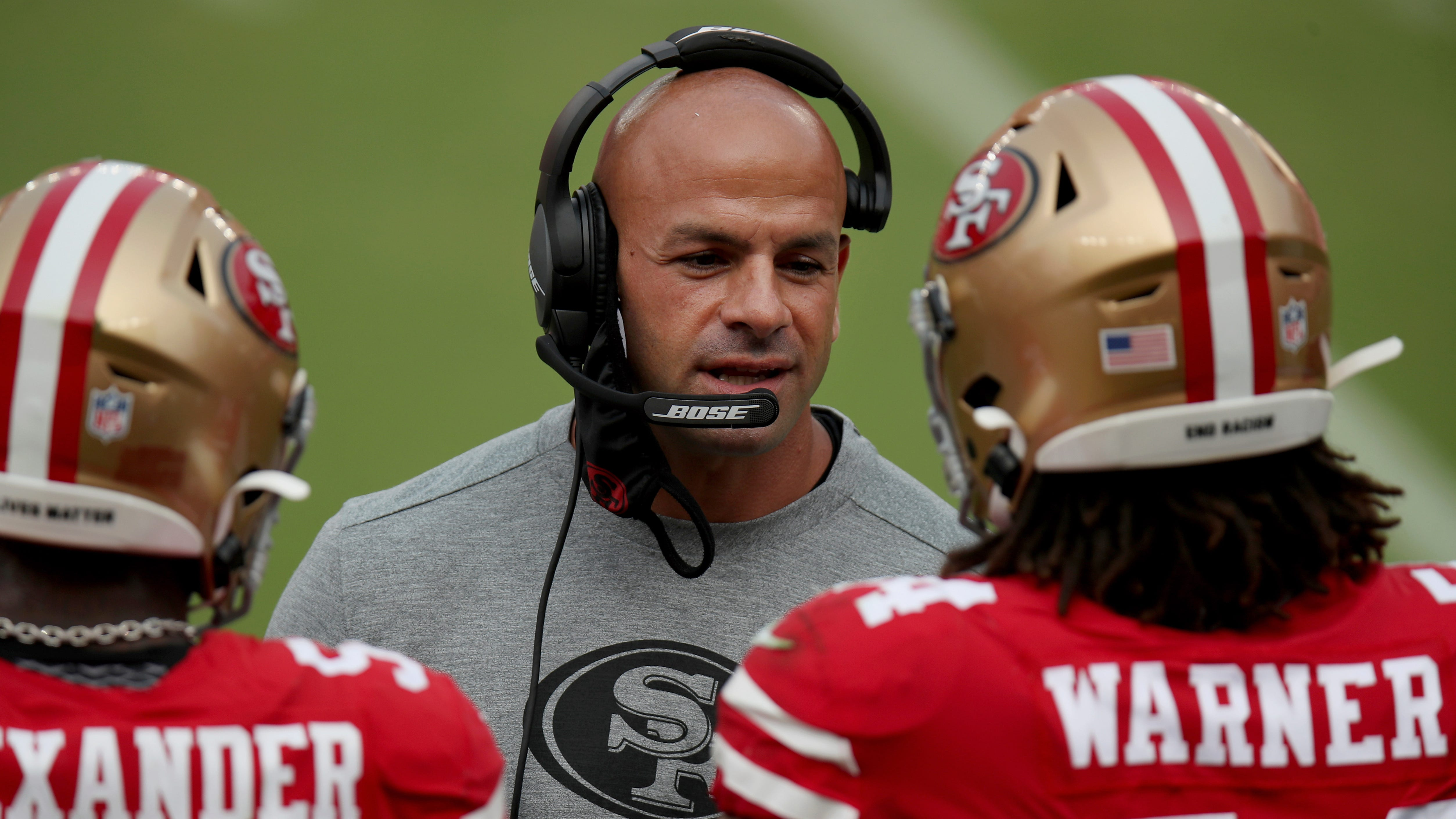 San Francisco 49ers defensive coordinator Robert Saleh on Sept. 13, 2020, talks to players on the sideline in Santa Clara, Calif.
