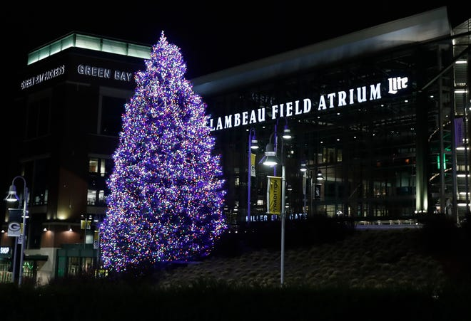 A 46-foot evergreen tree was decorated with more than 10,000 lights in front of the Lambeau Field Atrium to celebrate the 2020 holiday season.