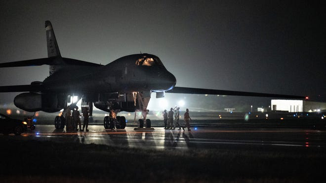 Maintenance personnel from Bomber Task Force operations conduct an inspection on a U.S. Air Force B-1B Lancer aon arrival at Andersen Air Force Base.