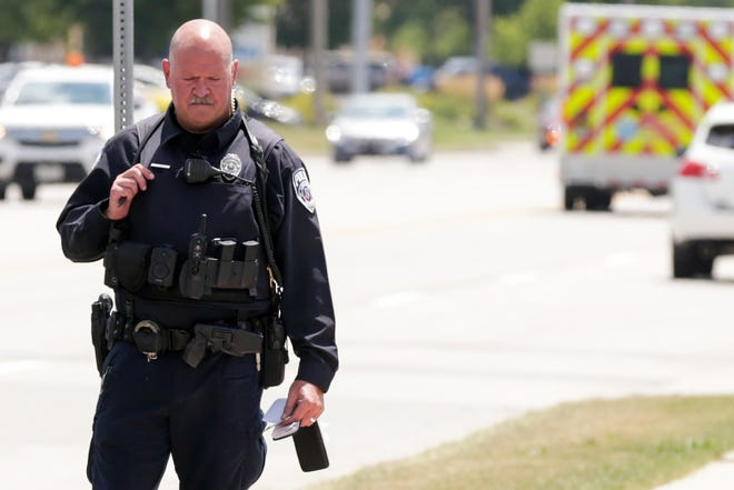 In this Wednesday, July 17, 2019 file photo, Lafayette Police K9 officer Ryan French investigates a shop lifting incident on Sagamore Parkway in Lafayette.
