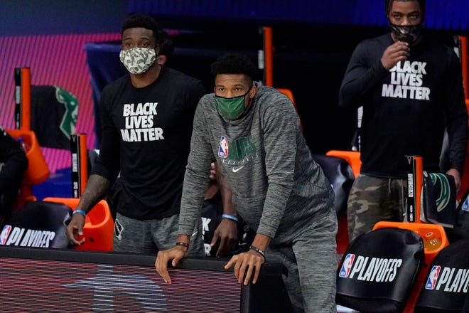 Bucks players were masked while on the bench after the NBA season resumed last season and are  adjusting to live outside the  bubble.