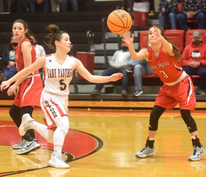 Norfork's Mesa Beavers (5) deflects a pass to Rural Special's Abbey Linville (3) on Monday night.