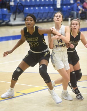 Mountain Home's Emma Wilber and Bentonville's Maryam Dauda battle for a rebound during a game earlier this season at The Hangar.