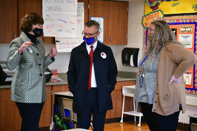 Muncie Community Schools CEO Lee Ann Kwiatkowski, Indiana Senator Jeff Raatz and West View Elementary dual language teacher Kelsey Pavelka discuss progress at the school on Dec. 8 during a visit by the senator, who chairs the state's education committee.