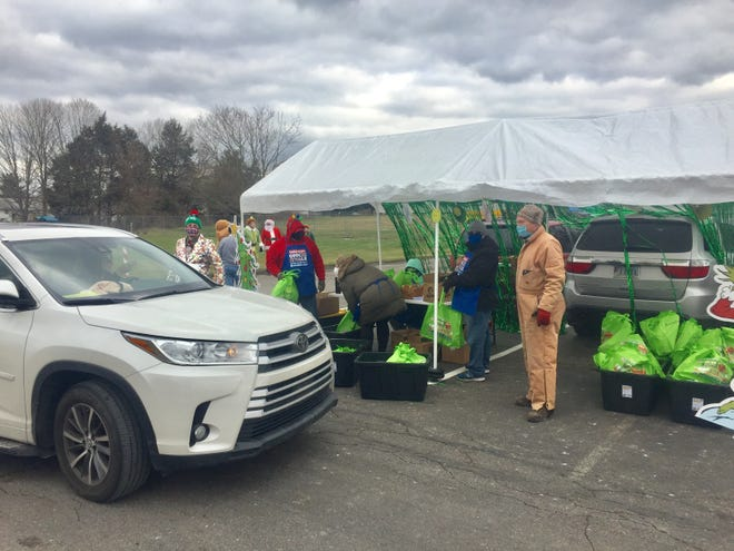 Cookies are distributed at the Dec. 5 Pataskala Lions Club Cookie Walk which became a cookie drive-thru because of COVID-19. Regardless, the event raised more money than last year to benefit a local food pantry.