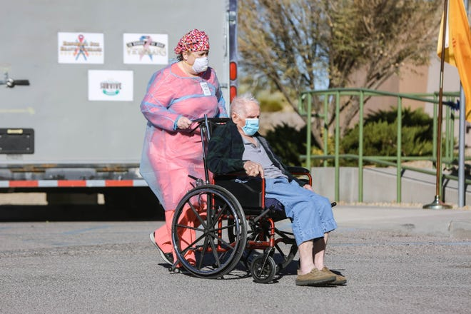 Kelly Sherry rolls out Elmer Hans in preparation for law enforcement car parade at the Haciendas at Grace Village assisted living facility in Las Cruces on Tuesday, Dec. 8, 2020.