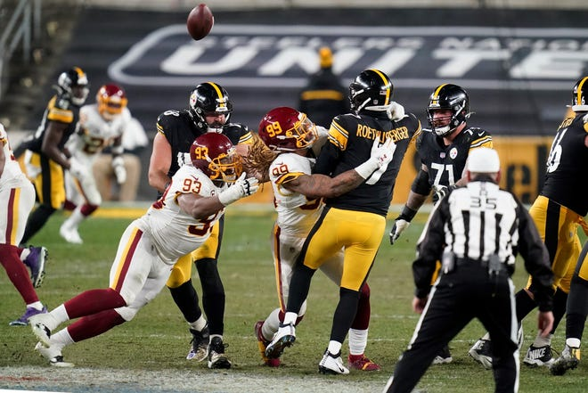 Pittsburgh Steelers quarterback Ben Roethlisberger (7) is hit by Washington Football Team defensive end Chase Young (99) after getting off a pass during the second half of an NFL football game, Monday, Dec. 7, 2020, in Pittsburgh. (AP Photo/Keith Srakocic)