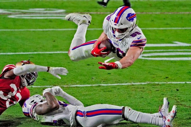 Buffalo Bills tight end Dawson Knox (88) leaps into the end zone for a touchdown against the San Francisco 49ers during the first half of an NFL football game, Monday, Dec. 7, 2020, in Glendale, Ariz. (AP Photo/Rick Scuteri)