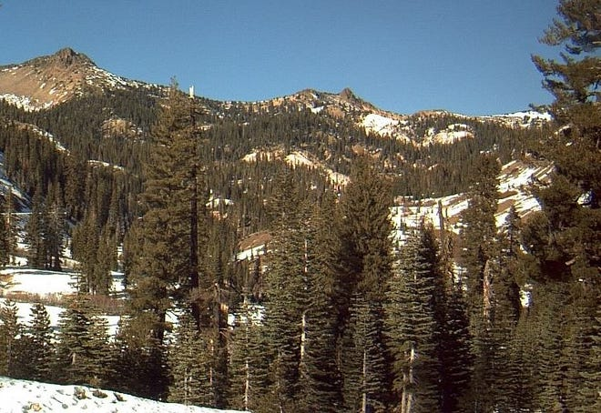 The Lassen Volcanic National Park webcam shows patchy snows on the mountains. Due to winter conditions, park officials have closed the road through the park.
