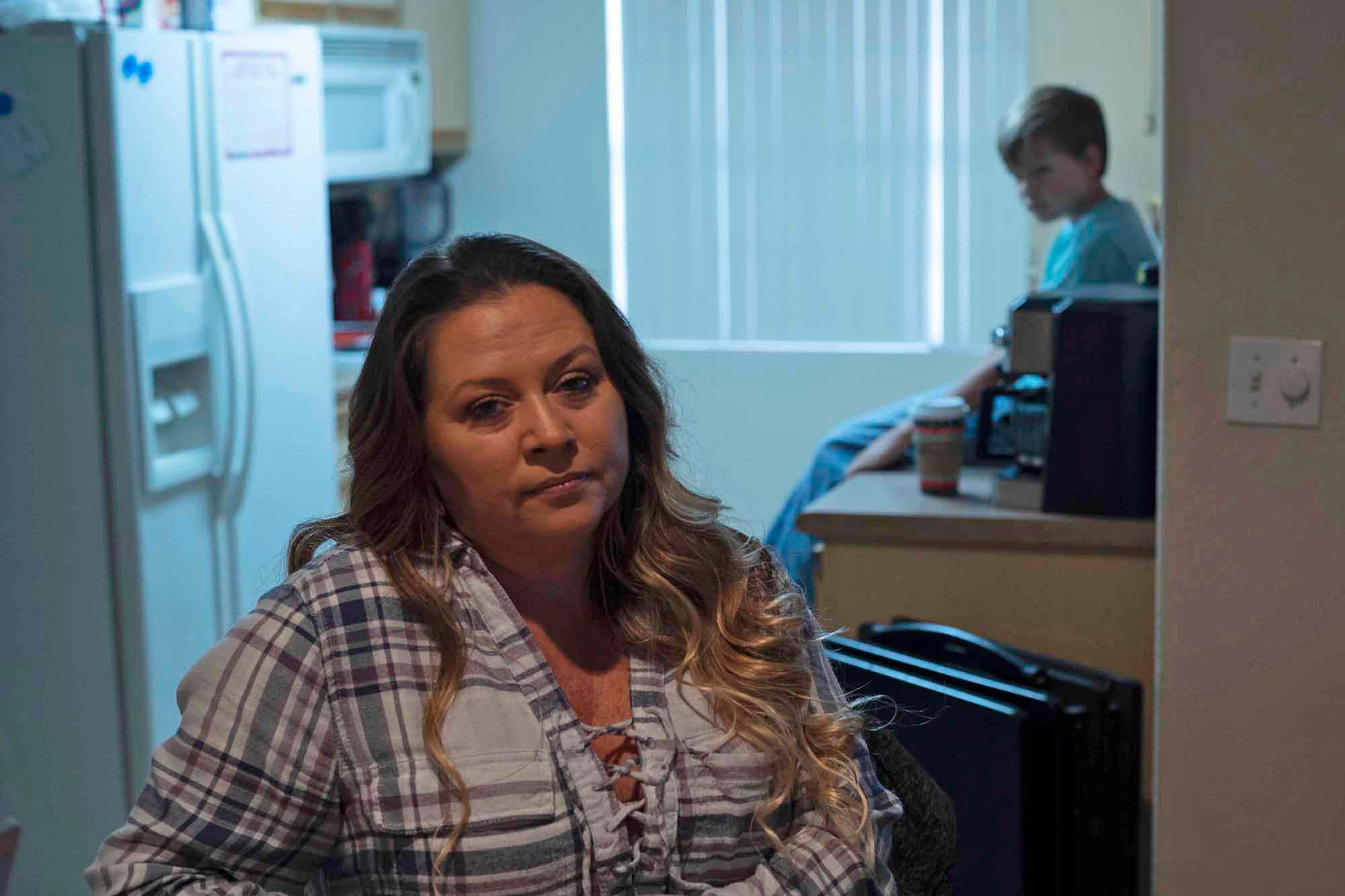 Waitress Teresa Trabucco can only work weekends when her son isn't in class. She's falling behind on rent and considering moving out of state.