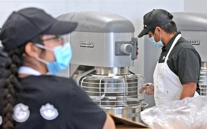 Staff at the new Crumbl Cookies location in San Angelo train on recipes Tuesday, Dec. 8, 2020.