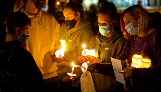 Mourners light candles at a vigil for Brixlee Marie Lee, a two-month-old girl who died after testing positive for heroin, on the Tom Green County Courthouse steps on Monday, Dec. 7, 2020.