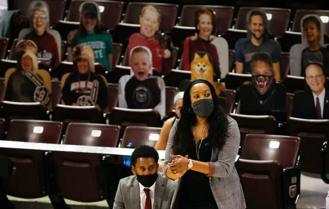 Missouri State Lady Bears head coach Amaka Agugua-Hamilton is flanked by cardboard cutouts as the Lady Bears take on the Lincoln Blue Tigers at JQH Arena on Dec. 7. On Monday night, the Lady Bears played Mizzou and came away with Missouri State's first win in Columbia since 2003.