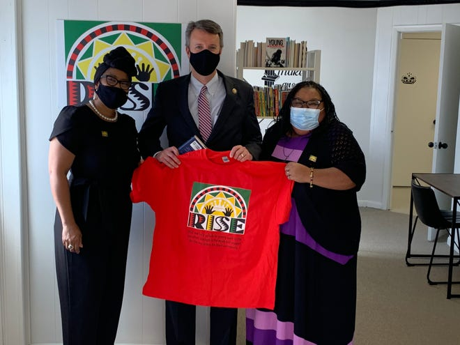 From left to right: RISE co-founder Sharon Fitz, U.S. Delegate Ben Cline and Rise co-founder Chanda McGuffin at the new All Black Library in Waynesboro, which opened in August.